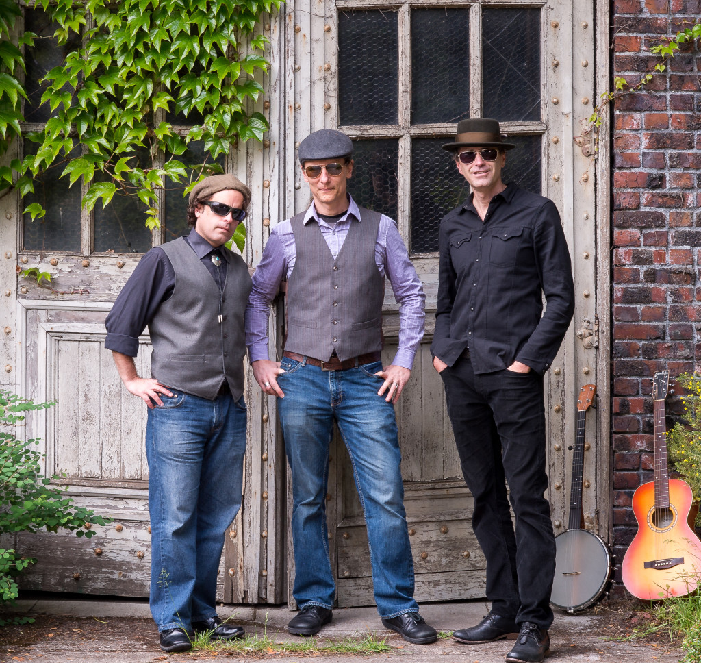 (l to r) Tim Connell - Mandolin, Wurlizter Michael Berly - Ukelele, Banjo, Guitar and Vocals Matty V. Hartless - Bass and Vocals